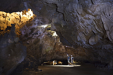 Hikers in the interior of Galaxy cave on the Ben Dang River in Thien Ha, Ninh Binh, Vietnam, Indochina, Southeast Asia, Asia