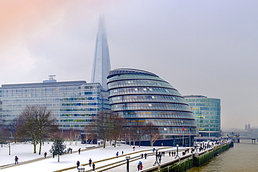 The South Bank of the River Thames showing the Shard and City Hall, HQ of the Mayor of London, in snow, London, England, United Kingdom, Europe