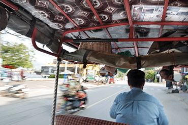 Tuk tuk driver in the streets of Kampt Town, Cambodia, Indochina, Southeast Asia, Asia