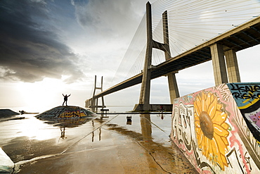 The colorful murals around Vasco Da Gama bridge emphasize its architecture and atmosphere at dawn, Lisbon, Portugal, Europe