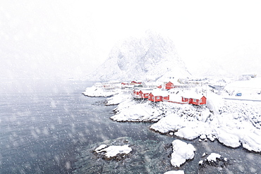 Heavy snowfall on the fishermen's houses called Rorbu surrounded by the frozen sea, Hamnoy, Lofoten Islands, Arctic, Norway, Scandinavia, Europe