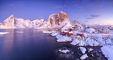Panoramic view of snowy peaks and frozen sea at dawn around the fishing village, Hamnoy, Nordland, Lofoten Islands, Arctic, Norway, Scandinavia, Europe