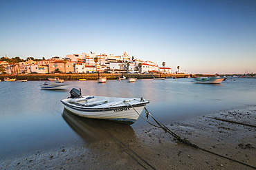 The colors of sunset on the fishing village of Ferragudo, Portimao, Algarve, Lagoa Faro District, Portugal, Europe