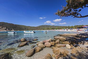 Boats in the turquoise sea surround the sandy beach of Cala Pira Castiadas, Cagliari, Sardinia, Italy, Mediterranean, Europe