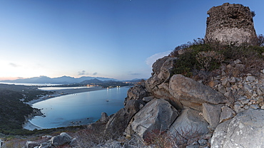 Top view of the bay with sandy beaches and lights of a village at dusk, Porto Giunco, Villasimius, Cagliari, Sardinia, Italy, Mediterranean, Europe