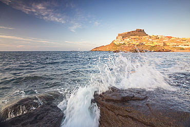Waves of blue sea frame the village perched on promontory, Castelsardo, Gulf of Asinara, Province of Sassari, Sardinia, Italy, Mediterranean, Europe