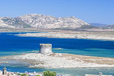 Turquoise sea and old tower surround La Pelosa Beach, Stintino, Asinara National Park, Province of Sassari, Sardinia, Italy, Mediterranean, Europe