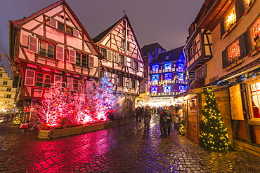 Typical houses enriched by Christmas ornaments and lights at dusk, Colmar, Haut-Rhin department, Alsace, France, Europe