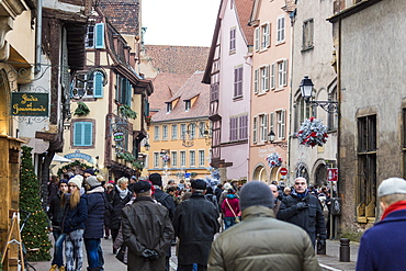 Tourists in the pedestrian road of the old town at Christmas time, Colmar, Haut-Rhin department, Alsace, France, Europe