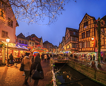 Panorama of Christmas Markets in the old medieval town of Colmar at dusk, Haut-Rhin department, Alsace, France, Europe
