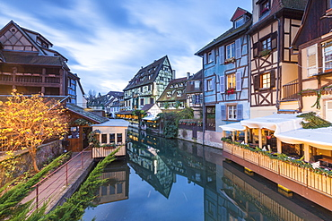 Dusk lights on houses reflected in River Lauch at Christmas, Petite Venise, Colmar, Haut-Rhin department, Alsace, France, Europe