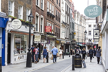 People flock to the shopping streets of Covent Garden, London, England, United Kingdom, Europe