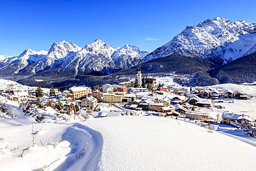 Blue sky on the alpine village of Ftan surrounded by snow, Inn district, Canton of Graubunden, Engadine, Swiss Alps, Switzerland, Europe