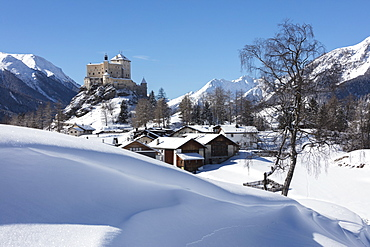 Old castle and alpine village of Tarasp surrounded by snowy peaks, Inn district, Canton of Graubunden, Engadine, Switzerland, Europe