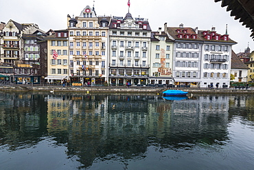 The typical buildings of the old medieval town are reflected in River Reuss, Lucerne, Switzerland, Europe