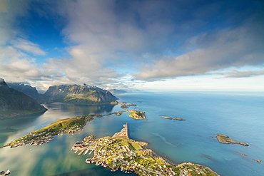 Blue sky and clouds frame the turquoise sea and the typical village, Reinebringen, Moskenesoya, Lofoten Islands, Norway, Scandinavia, Europe
