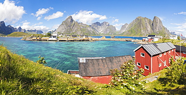 Panorama of turquoise sea and typical fishing village surrounded by rocky peaks, Sakrisoy, Reine, Moskenesoya, Lofoten Islands, Norway, Scandinavia, Europe