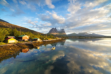 Pink clouds of midnight sun reflected in the clear water of blue sea, Anepollen Fjord, Nordland, Norway, Scandinavia, Europe