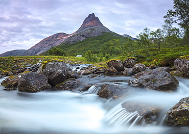 Waterfall frames the Stetinden mountain peak illuminated by midnight sun, Tysfjord, Nordland, Norway, Scandinavia, Europe