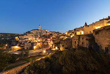 Dusk on the ancient town and historical center called Sassi, perched on rocks on top of hill, Matera, Basilicata, Italy, Europe