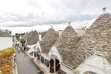 The typical huts called Trulli built with dry stone with a conical roof, Alberobello, UNESCO World Heritage Site, Province of Bari, Apulia, Italy, Europe