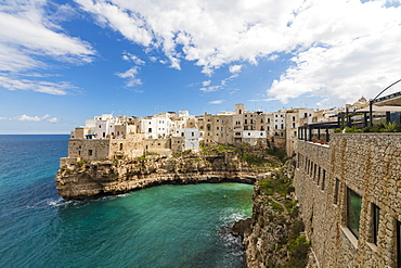 Turquoise sea framed by the old town perched on the rocks, Polignano a Mare, Province of Bari, Apulia, Italy, Europe