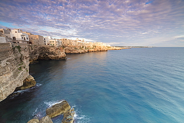 Sunrise on the turquoise sea framed by old town perched on the rocks, Polignano a Mare, Province of Bari, Apulia, Italy, Europe