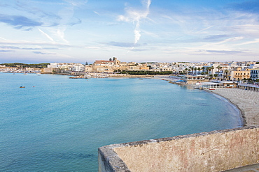 Turquoise sea frames the beach and the medieval old town Otranto, Province of Lecce, Apulia, Italy, Europe