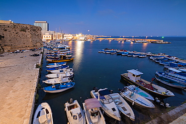 Dusk lights the harbor and the medieval old town of Gallipoli, Province of Lecce, Apulia, Italy, Europe
