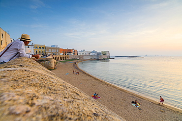 Sunset frames the beach and the turquoise sea, Gallipoli, Province of Lecce, Apulia, Italy, Europe