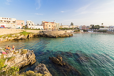 Turquoise sea and cliffs frame the fishing village of Santa Maria al Bagno Gallipoli, Province of Lecce, Apulia, Italy, Europe