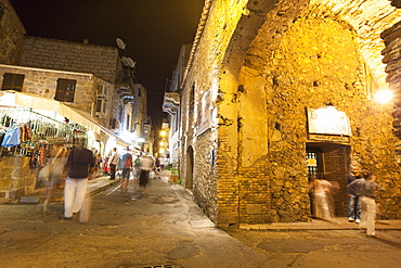 Tourists in the medieval alleys of the old town, Porto Vecchio, Corsica, France, Europe
