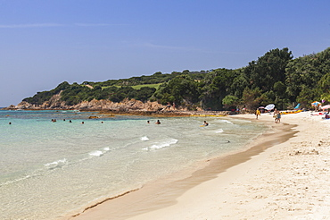 Bathers on sandy beach surrounded by turquoise sea and golf course, Sperone, Bonifacio, South Corsica, France, Mediterranean, Europe