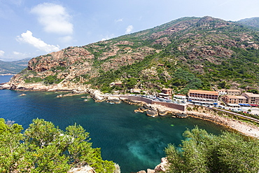 Top view of turquoise sea framed by green vegetation and the typical village of Porto, Southern Corsica, France, Mediterranean, Europe