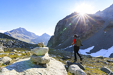 Hiker on the trail to Lej Lagrev, St. Moritz, Engadine, Canton of Graubunden, Switzerland, Europe