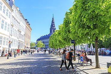 People walk in the pedestrian road towards Christiansborg Palace, Copenhagen, Denmark, Europe