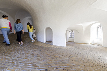 People in the spiral ramp inside the Round Tower (Rundetaarn), Copenhagen, Denmark, Europe