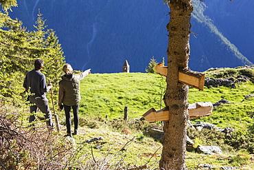 Hikers on Sentiero del Carbonaio, San Romerio Alp, Brusio, Poschiavo Valley, Canton of Graubunden, Switzerland, Europe