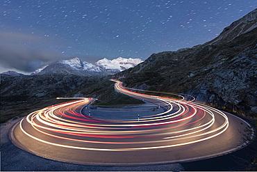 Star trail and lights of car traces, Bernina Pass, Poschiavo Valley, Engadine, Canton of Graubunden, Switzerland, Europe