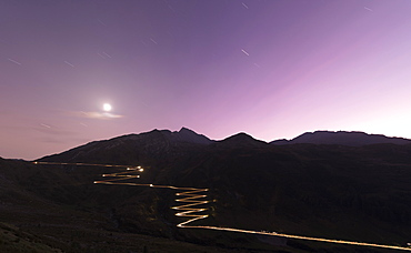 Lights of car traces at dusk, Spluga Pass, Chiavenna Valley, Switzerland, Europe
