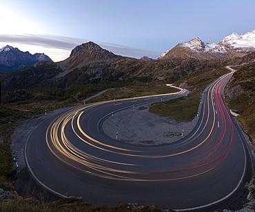 Panoramic of lights of car traces, Bernina Pass, Poschiavo Valley, Engadine, Canton of Graubunden, Switzerland, Europe
