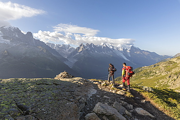 Hikers on footpath leading to Lacs De Cheserys from Argentiere, Haute Savoie, French Alps, France, Europe