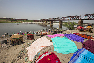 Colorful clothes drying in the sun on the banks of the River Yamuna, a polluted tributary of the Ganges, New Delhi, India, Asia