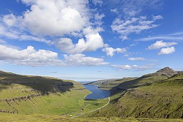 Cliffs and sea at Kollafjorour fjord, Streymoy Island, Faroe Islands, Denmark, Europe