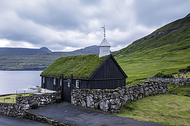 The wooden turf roofed church in Funningur, Eysturoy Island, Faroe islands, Denmark, Europe