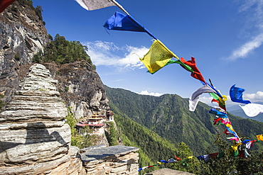 The colorful Tibetan prayer flags invite the faithful to visit the Taktsang Monastery, Paro, Bhutan, Asia