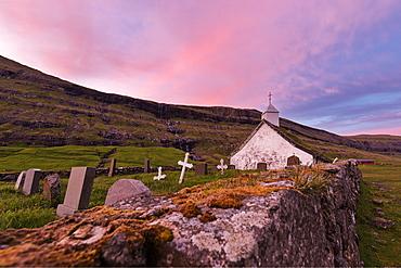 Pink sunset on church and cemetery, Saksun, Streymoy Island, Faroe Islands, Denmark, Europe