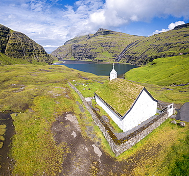 Elevated view of typical church in Saksun, Streymoy Island, Faroe Islands, Denmark, Europe (Drone)