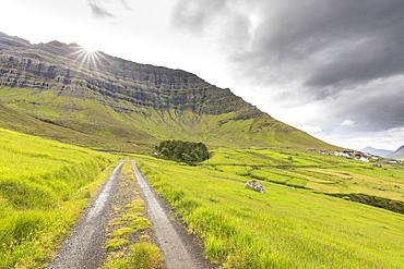 Sunbeam on green meadows, Kunoy Island, Nordoyar, Faroe Islands, Denmark, Europe