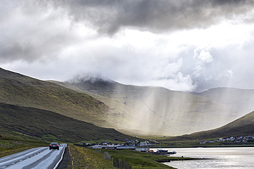 Car on road to Hvalvik, Streymoy Island, Faroe Islands, Denmark, Europe